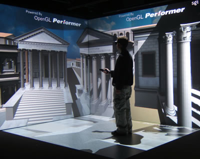 Student using tablet PC in the FLEX theatre displaying a model of the Roman Forum