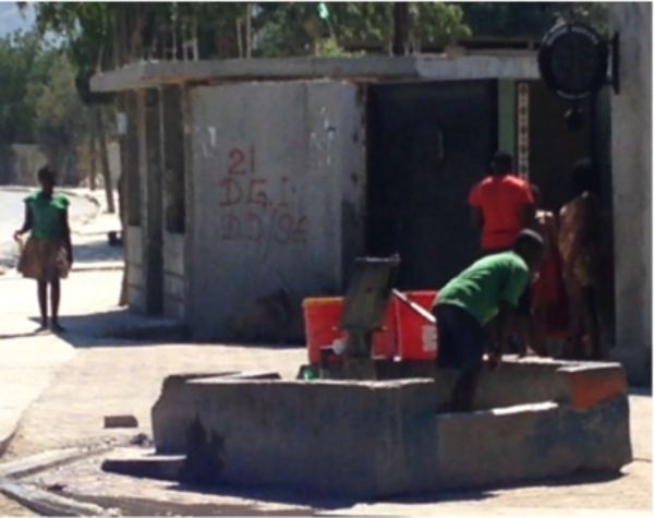 Hand-pumped water well in Port-au-Prince neighborhood