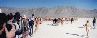 nudes gather in the desert